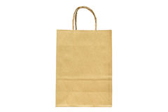 Brown paper shopping bag with handles over on white background. Royalty Free Stock Photo