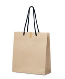 Brown paper shopping bag isolated on white background. Royalty Free Stock Photo