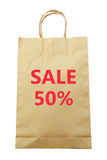 Brown paper shopping bag with Sale 50 % text isolated on white background (clipping path) Stock Image