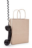Brown paper shopping bag and telephone Stock Image