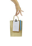 Brown paper shopping bag with telephone on white background Royalty Free Stock Image