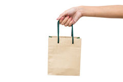 Brown paper shopping bag with white background Royalty Free Stock Photos