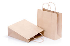Brown paper shopping bags. A pair of brown paper shopping bags stock photography