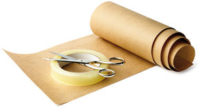Brown paper and sticky tape and scissors ready for Royalty Free Stock Image