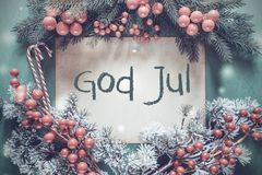Christmas Garland, Fir Tree Branch, God Jul Means Merry Christmas. Brown Paper With Swedish Text God Jul Means Merry Christmas. Christmas Garland With Fir Tree stock images