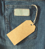 Brown paper tag of jean. Empty brown paper tag of jean. effect Stock Images