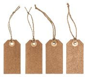 Brown paper tag string white background. Brown paper tag with string isolated on white background stock image