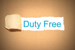Brown paper torn to reveal duty free Royalty Free Stock Photography