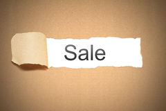 Brown paper torn to reveal sale Royalty Free Stock Photography