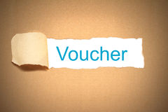 Brown paper torn to reveal voucher Royalty Free Stock Photography