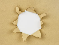 Brown paper and white  hole Stock Image