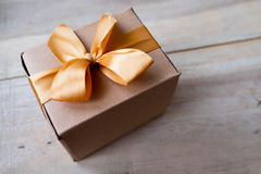 Brown paper wrapped gift box Stock Photography