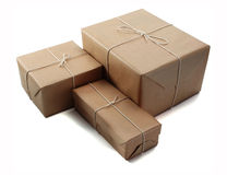 Brown parcels. Brown paper parcels ready to be shipped brightly lit on isolated white background stock photos
