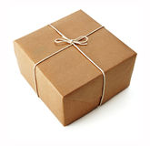 Brown parcels. Brown paper parcels ready to be shipped brightly lit on isolated white background royalty free stock photography