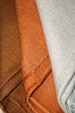 Brown pashmina shawls. Close-up of three brown pashmina winter shawls Royalty Free Stock Image