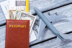 Brown passport and toy plane. Royalty Free Stock Photography