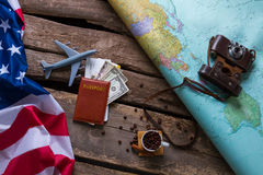 Brown passport and US flag. Royalty Free Stock Images