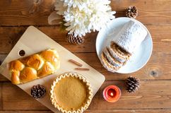 Brown Pastry and Cupcake in Chopping Board Royalty Free Stock Image