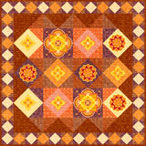 Brown patchwork quilt Stock Image