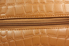 Brown patent leather with a lock  background Royalty Free Stock Images