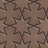 Brown Paving Slabs Laid in the Form of Stars and Royalty Free Stock Photo