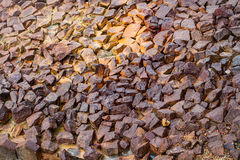 Brown pebbly road. A dirty brown pebbly road with rays of the sun Royalty Free Stock Image