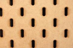 Brown pegboard tekstury tło fotografia stock