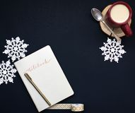 Brown Pen on White Notebook Near Red Coffee Mug and Silver Spoon on Top of Blue Surface Stock Photos