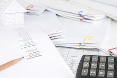 Brown pencil on earnings statement have blur house and paperwork Royalty Free Stock Photos
