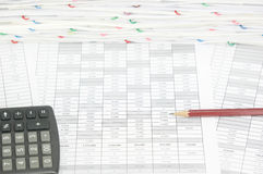 Brown pencil on finance account with calculator. Have pile of document as background stock image