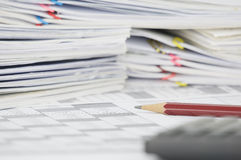 Brown pencil on finance account have blur calculator as foreground. Brown pencil on finance account have blur calculator and blur step pile of document as royalty free stock photography