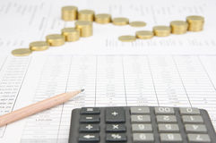 Brown pencil have blur calculator and blur step gold coins. Brown pencil have blur calculator as foreground and blur step of gold coins on finance account as Royalty Free Stock Images