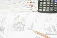 Brown pencil and house on balance sheet Stock Images