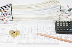 Brown pencil and pile of gold coins with calculator. On finance account have pile of paperwork as background stock photos