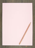 Brown pencil on pink paper Stock Image