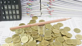 Brown pencil rotate on stack silver and gold coins time lapse stock video footage