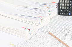 Brown pencil with step pile of paperwork as background. Brown pencil on finance account have calculator and step pile of paperwork as background Royalty Free Stock Photos