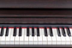 Brown piano closeup Royalty Free Stock Images