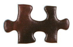 Brown piece of jigsaw puzzle close up Stock Images