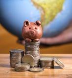 Brown piggy bank Stock Photos