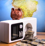 Brown piggy on electric meter Royalty Free Stock Photography