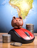 Brown piggy on mouse Royalty Free Stock Photos