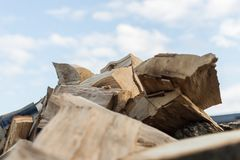 Brown pile of wood on the fresh air stock photo