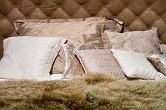 Brown pillows with furry duvet. On the bed Royalty Free Stock Images