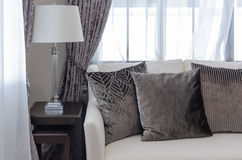 Brown pillows on sofa in luxury living room Royalty Free Stock Photos