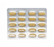 Brown pills in a blister pack Royalty Free Stock Photos
