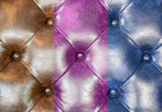Brown, pink and blue leather upholstery sofa background.  Stock Images