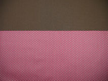 Brown and pink polka dot background Stock Images