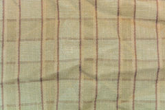 Brown plaid cotton fabric for the background Stock Photos