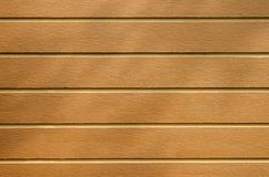 Brown plank floor with shade of trees stock photo